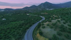 Scenery aerial shot of nature landscape with small road stock video footage