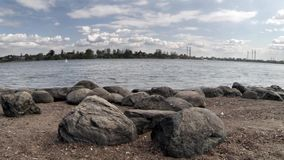 Scenery with ancients  boulders at riverside stock video footage