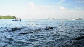 Scenery of Ao Yon Bay with unrecognizable peoples playing kayak in the sea, Beauty of andaman sea.