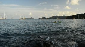 Scenery of Ao Yon Bay with unrecognizable peoples playing kayak in the sea.