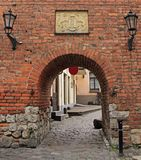 Scenery arch passageway in old city of Riga, Latvia. Riga, Latvia - April 29, 2017: scenery arch passageway in old city of Riga, Latvia Stock Images
