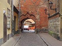 Scenery arch passageway in old city of Riga, Latvia stock photo