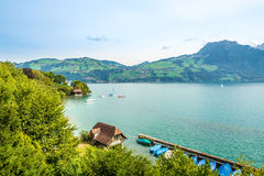 The scenery around the lake Thun in Spiez - Switzerland. SPIEZ,SWITZERLAND - SEPTEMBER 3,2016 - The scenery around the lake Thun in Spiez. Spiez Castle is a stock photography