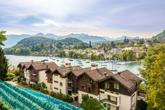 The scenery around the lake Thun in Spiez - Switzerland. SPIEZ,SWITZERLAND - SEPTEMBER 3,2016 - The scenery around the lake Thun in Spiez. Spiez Castle is a royalty free stock photography