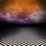 Scenery with black and white checker floor and colorful clouds Royalty Free Stock Photography