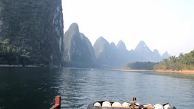 The scenery on both sides of the river. Guilin, China, green mountains and rivers, above the cruise ship stock video footage