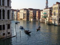 Scenery of a canal in Venice on a sunny day Stock Photos