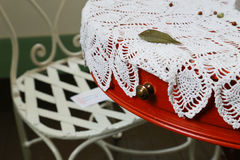 Scenery of a chair and the table. Scenery of the round table and chair with the lacework Stock Photography
