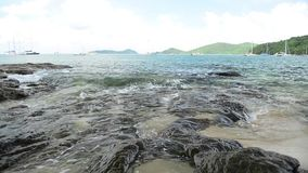 Scenery of coastline at Ao Yon beach, waves washed up on the rocks in low angle view. Scenery of coastline at Ao Yon beach, waves washed up on the rocks in low stock video footage
