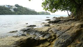 Scenery of coastline at Ao Yon Beach, Waves washed up on the rocks. Scenery of coastline at Ao Yon Beach, Waves washed up on the rocks, Phuket, Thailand stock footage