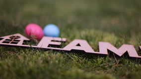 Scenery for Easter. Multi-colored easter eggs. wooden word `family stock video footage