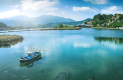 Scenery with fisherman boat Stock Image