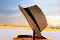 Scenery with a hat. An artist hat in front of scenery Stock Image
