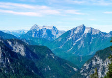 Scenery of high mountain with high peak in sunny day Stock Images