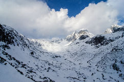 Scenery of high mountains wiht snow and cloud atmosphere Royalty Free Stock Photo
