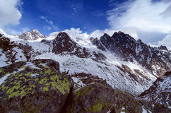 Scenery of high mountains wiht snow and cloud atmosphere Royalty Free Stock Image