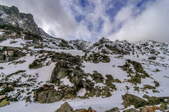Scenery of high mountains wiht snow and cloud atmosphere Royalty Free Stock Images