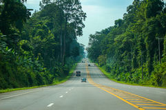 Scenery of highway in Krabi, Thailand. Beautiful scenery of highway from Krabi to Phuket, Thailand beside with green rain forest and big mountain along the road Stock Image