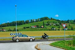Scenery with hills and Car motorcycle on Road Maribor Slovenia. Scenery with hills and Car and motorcycle on the Road in Maribor in Slovenia stock photo