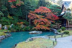 Japanese Garden Stone Bridge stone path japanese garden stone bridge across pond stock photos