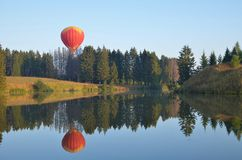 The scenery on the lake with a balloon. Stock Image