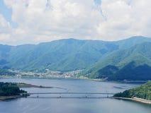 Scenery of Lake Kawaguchi, the biggest lake of Fuji five lakes, with an overwater bridge crossing the lake stock image