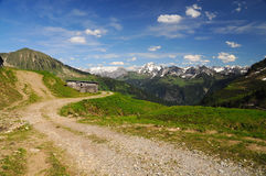 Scenery Landscape in the Alps with a beautiful road and a mountain hut Royalty Free Stock Image