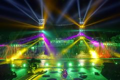 Light show. The scenery of light show with many colors of spotlights stock photography