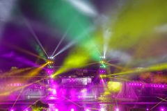 Light show. The scenery of light show with many colors of spotlights royalty free stock photo
