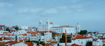 Scenery of Lisbon. Panoramaview of Alfama old town district on cloudy day, Lissabon, Portugal. Red-white colored stock images