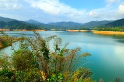 Scenery of man made lake at Sungai Selangor dam during midday.  Royalty Free Stock Photo