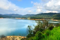 Scenery of man made lake at Sungai Selangor dam during midday.  Stock Photography