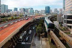 Scenery of a metro train traveling on elevated rails of Monorail near Tennozu Isle Station in Tokyo royalty free stock photography