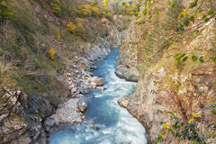 The scenery of the mountain gorge with the river Stock Photography