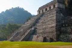 The scenery of the mountains and the ancient Maya pyramid. Palenque, Chiapas, Mexico. The scenery of the mountains and the ancient Maya pyramid. The famous royalty free stock image