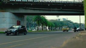 A Scenery near Bintaro jaya traffic light. A crowded road near Bintaro jaya traffic light in Bintaro, Indonesia stock video footage