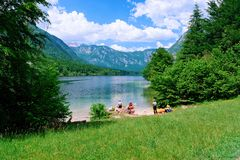 Free Scenery Of People Canoeing On Bohinj Lake In Slovenia Stock Images - 166474334