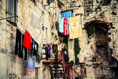 Scenery in old part of town showing laundry day. And clothes drying on a rope Royalty Free Stock Photography