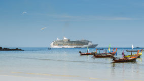 Scenery of patong beach with long tail boats and luxury cruise, Royalty Free Stock Images