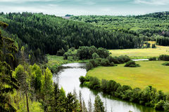 Scenery with pine forest, river and meadows Stock Photo