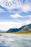 Scenery of river and mountain. Under sky Royalty Free Stock Image