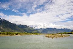 Scenery of river and mountain. Under sky Stock Photos