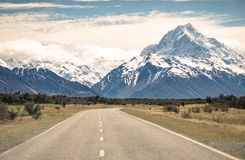 Scenery road or street travel to Mountains in New Zealand. Snow mountain range stock photography