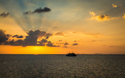 Scenery of the sea during sunset with ferry Royalty Free Stock Image
