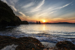 Scenery seascape: sunset over Pacific Ocean. Seascape of Kamchatka Peninsula: beautiful view of sunset over Three Brothers Rocks in Avacha Bay Pacific Ocean Stock Photo