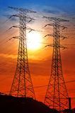 Scenery of silhouetted electrical tower Royalty Free Stock Photos