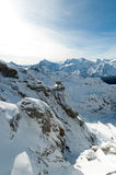 Scenery of snow covered mountains valley Titlis, Engelberg Stock Photos