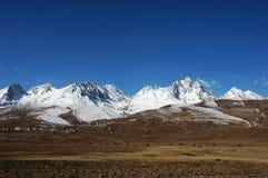 Scenery of snow mountains Stock Photos