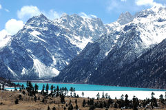 Scenery of snow mountains and blue lake Stock Photos