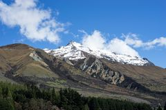 Scenery of snow mountains range in New Zealand with blue clear s royalty free stock photo